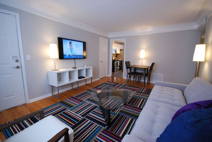 Brookwood Courtyard Condos - Stylish Living Room with 50-inch LED TV