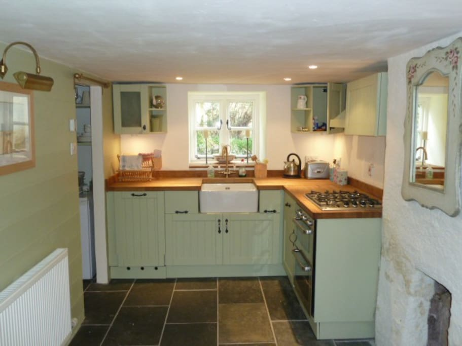 Handcrafted and painted kitchen/dining room with underfloor heating.  Side room with fridge and freezer