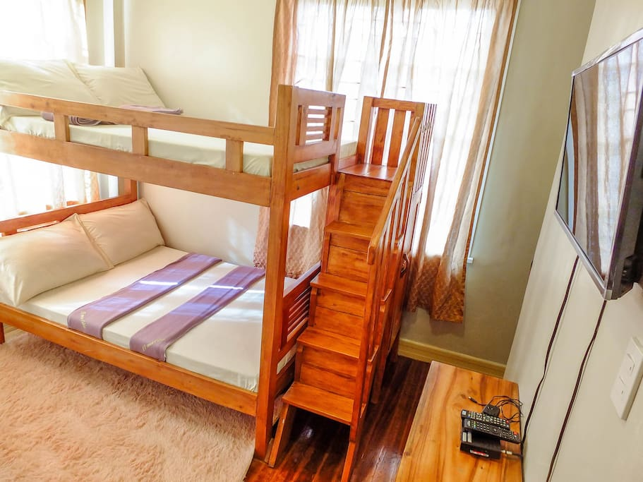 """Double-size loft-type bunkbed, very sturdy non-wobbly, 32"""" flat panel cable TV."""