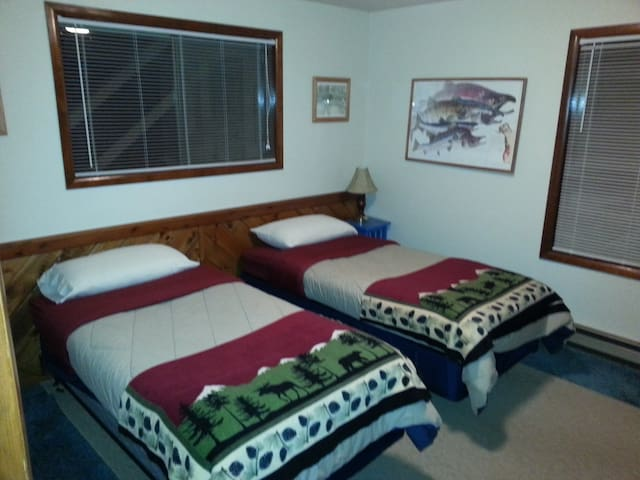 The west bedroom configured with two single beds.