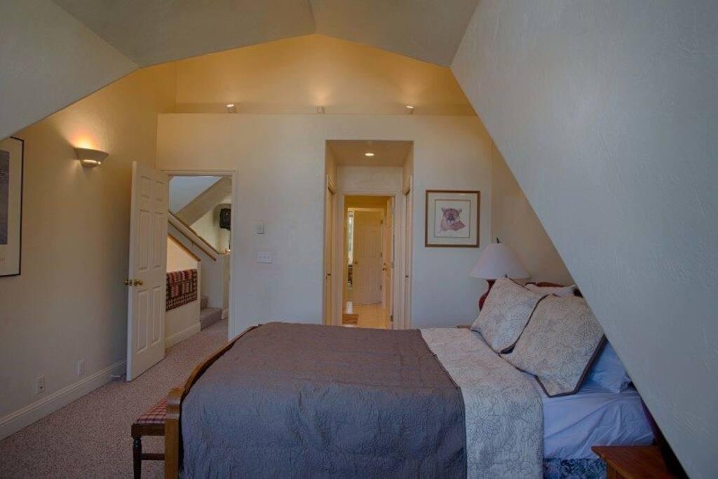 Second floor bedroom with queen bed.