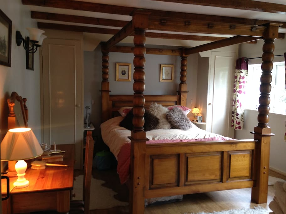 main bed room 4 poster bed with down stair bathroom all on one floor