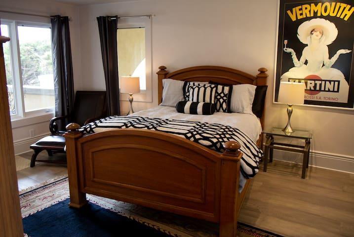 Queen bed in Bedroom 3.