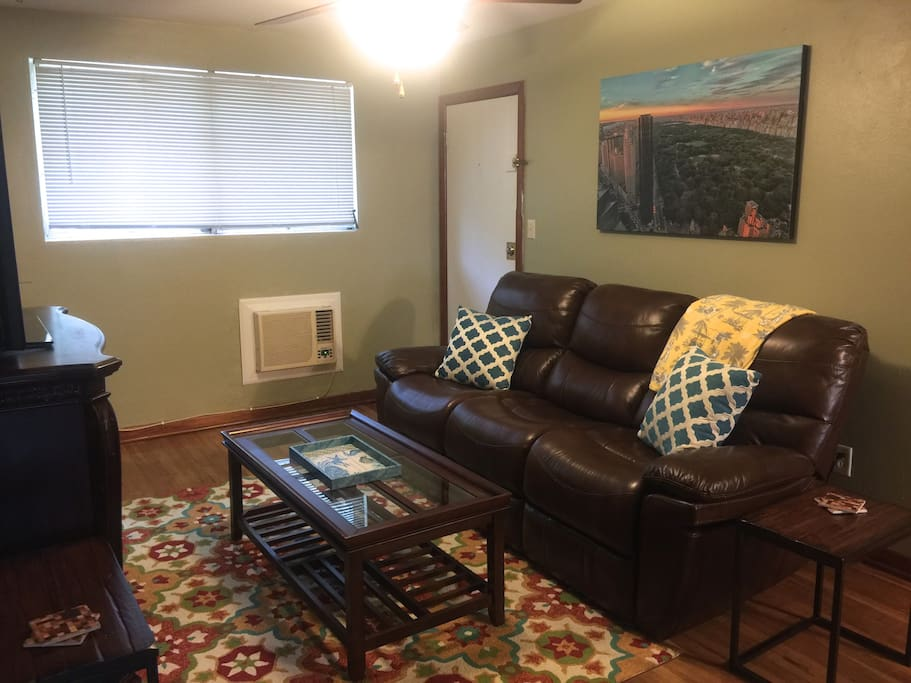 Comfortable reclining leather sofa.  Large screen TV, wifi, cable.