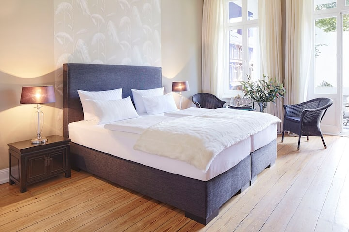 Suite mit Terrasse in stilvollen Stadthaus
