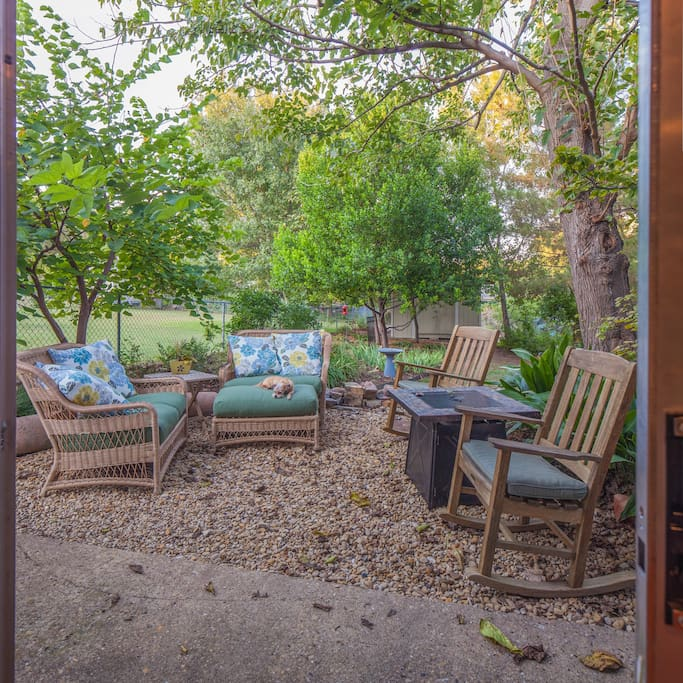 You have patio seating outside your kitchen door and a porch swing outside the living room door.