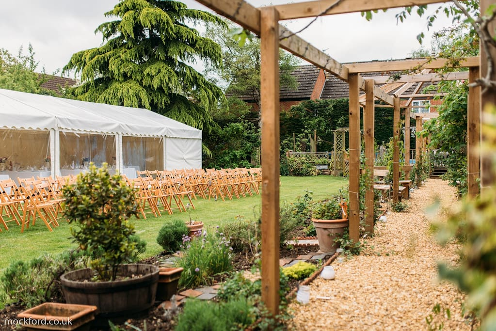Marquee and an open air ceremony in beautiful garden