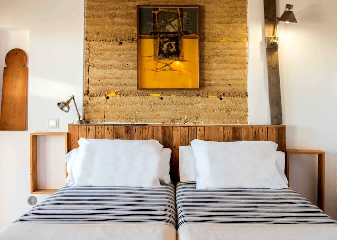 Room Madeira  is one of the 4 exterior rooms and is located in the garden of Casa Terra and has a seperate entrance A spacious room with a private terrace and  direct access to the pool, the pond and the dojo without going through the common areas.