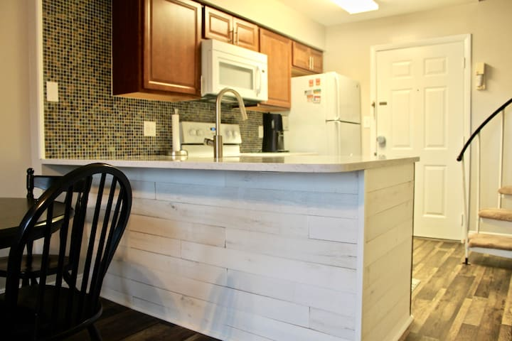 Brand new kitchen cabinets, appliances, counter top, sink, faucet and flooring for 2018!