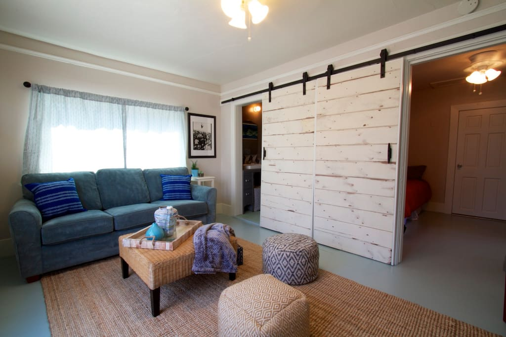 Large shiplap barn doors lead to bedroom #2 and bath