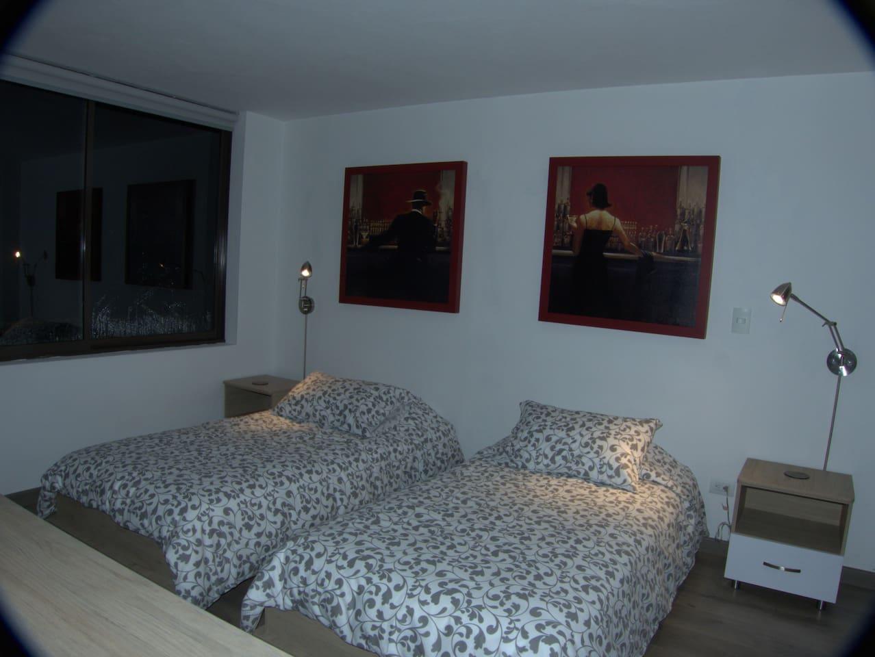 """ALCOBA # 1 """"ACACIA"""",  2 camas sencillas, t.v, caja de seguridad, vestier, baño y terraza con mesa y parasol"""