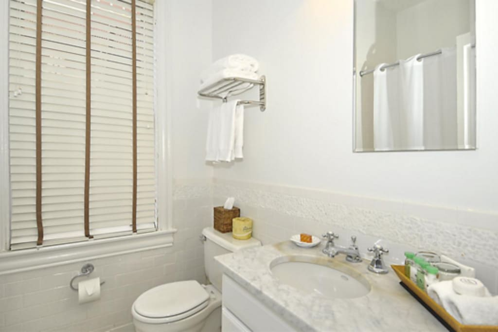Classic tile and marble countertops, cotton towels and upscale bath amenities