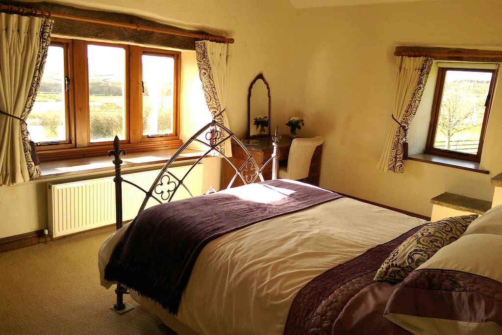 A beautiful bedroom with bags of character and long distance views