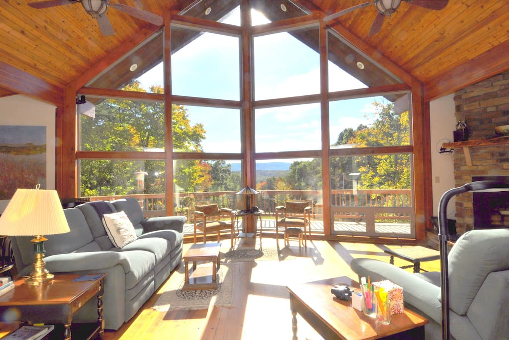 Guests love the large open living space with high ceilings and chalet windows.