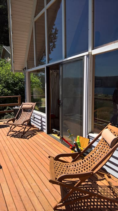 Floor to ceiling windows lead to large beachfront deck.