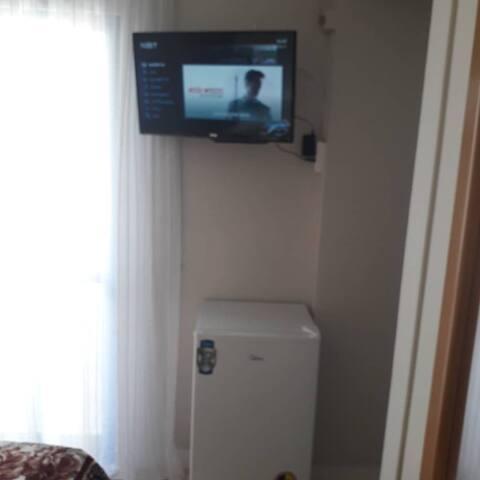frigobar , TV a cabo