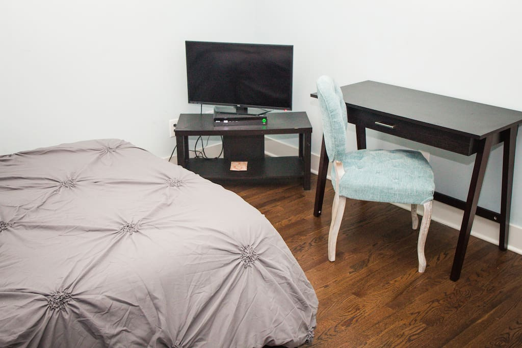 Bedroom 1 - Queen Bed with Television and Desk