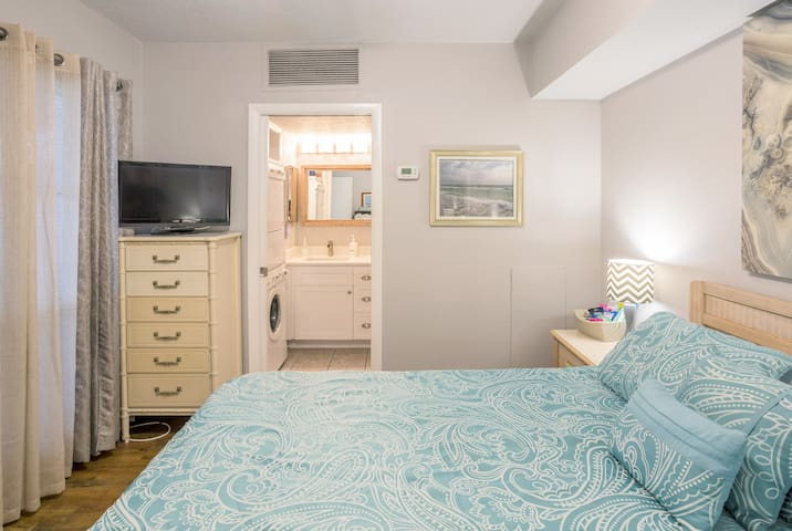 Master bedroom with comfy bed and plenty of storage, plus flat screen TV with cable and streaming services