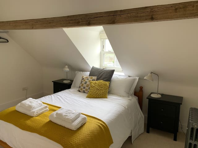 Double bedroom on the top floor, with access to a shared bathroom.