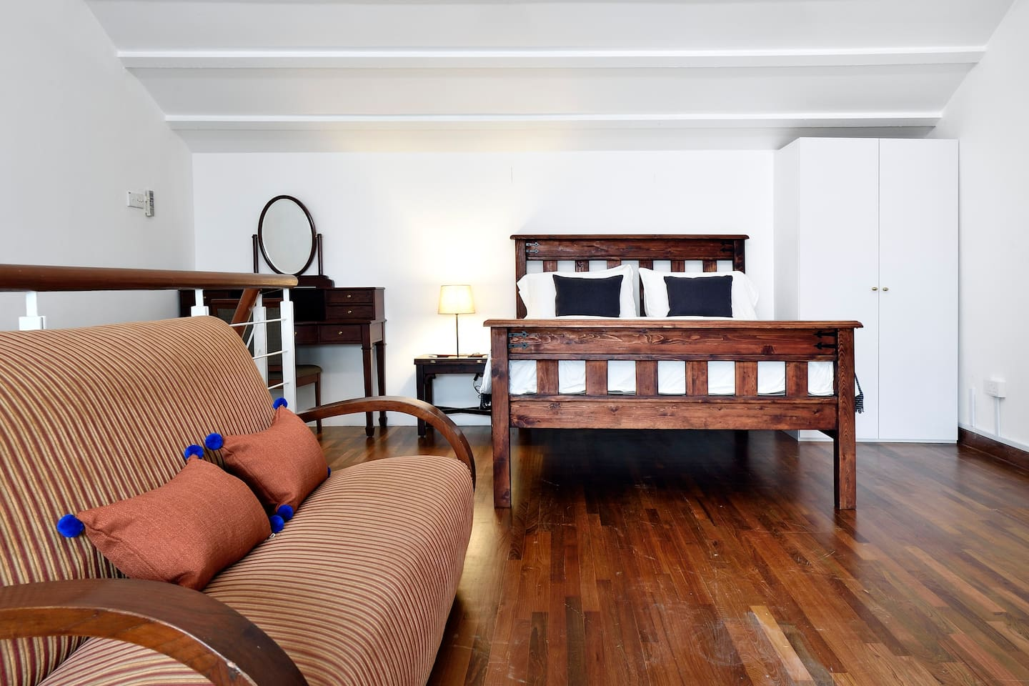 Our Bencoolen Suite with a Queen size bed and antique teakwood furniture from the iconic Raffles Hotel!
