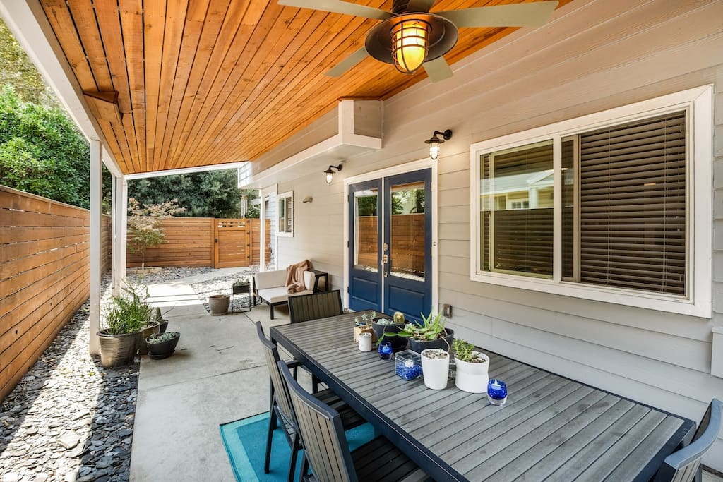 The front patio features outdoor seating for eight people.