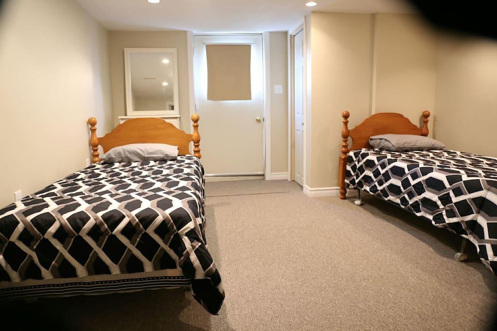 basement bedroom-ground level; door opens to driveway