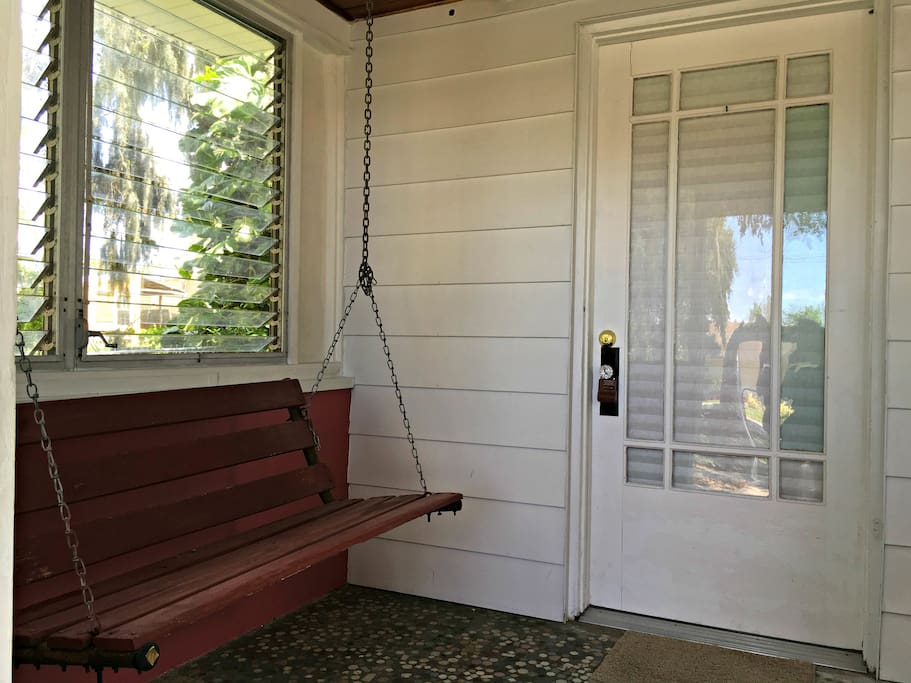 Front porch with swing.