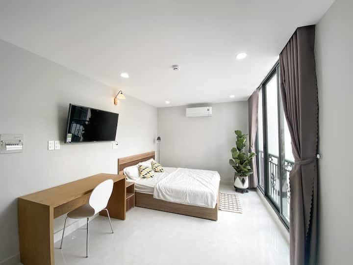 Large window studio near City Center and Airport
