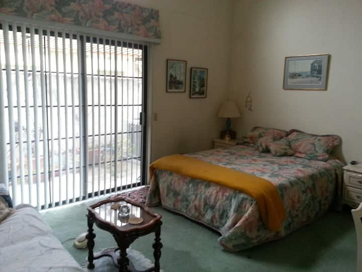 Furnished master bdrm w/private bthrm & patio