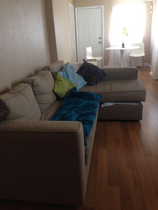 Clean linen storage underneath couch.