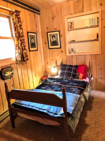 Guest bedroom, twin bed. Room for available pack and play to be added.