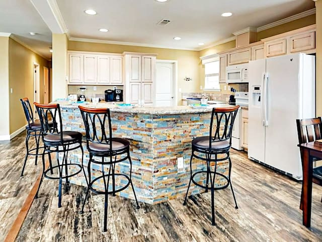 A unique and colorful breakfast bar adds an artistic touch and offers seating for 4.