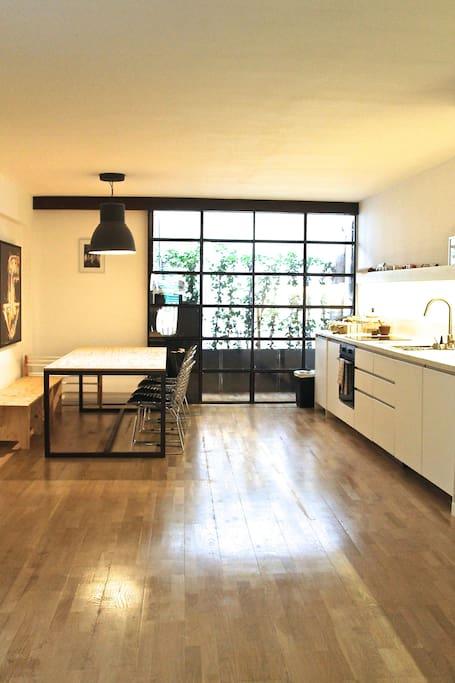 Bespoke furniture gives this space a 'Manhattan' loft feel.
