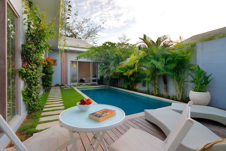 Wooden deck overlooking the 7x3m pool with 4 daybeds in total. There are 2 pools.