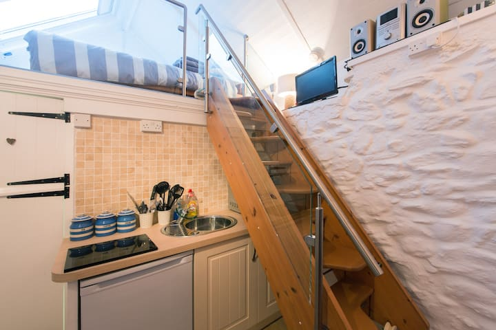 Kitchen and stairs leading to mezzanine