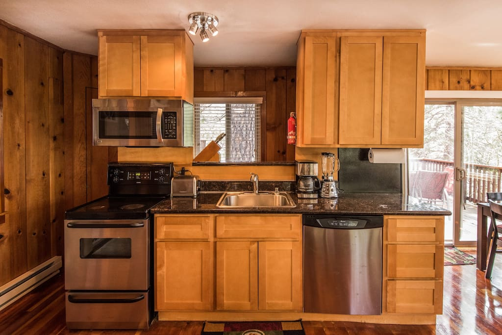 Stainless, granite and maple kitchen.  Dishwasher, fridge/freezer with water and ice maker, microwave, oven stove and fully stocked cooking utensils