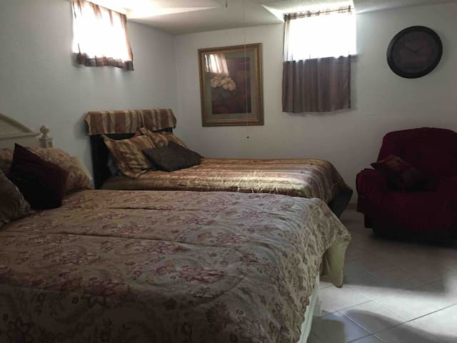 Master 2-queen bedroom with spacious private no step wet shower bath. Desk closet/chair & lounge chair. Heated tile floor.