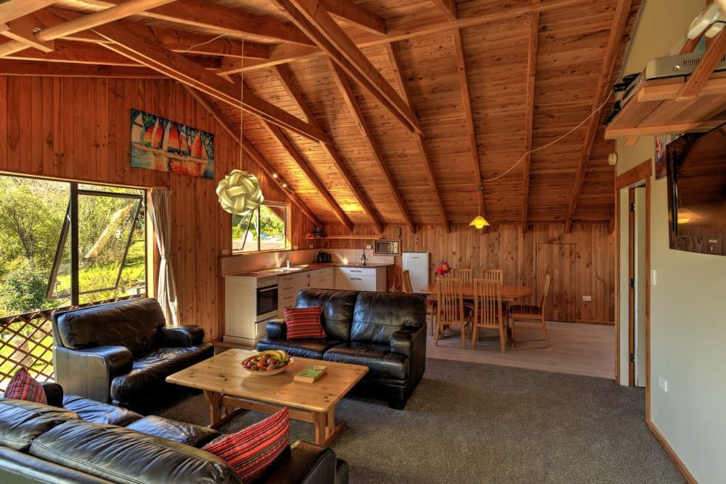 It shows the light in the kitchen, the beautiful ceiling, open plan living area with the comfortable leather couches. Cozy to relax after a long and beautiful day in the Park