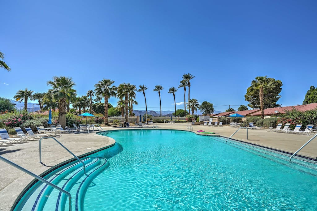 Spend your days lounging by the expansive community pool while you admire the mountainous views.