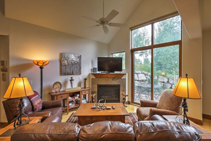 The gorgeous, rustic home features tall cathedral ceilings and large windows.
