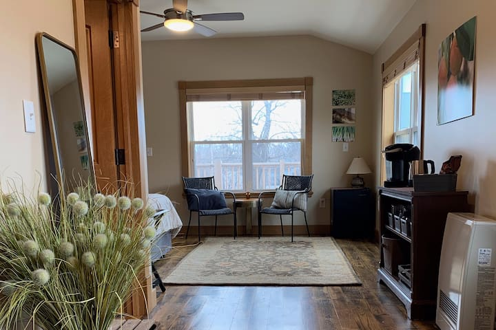 Unique, light-filled suite overlooking urban farm!