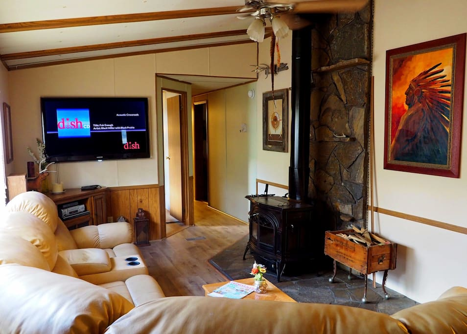 "Living Room 55"" TV, wood burning stove"