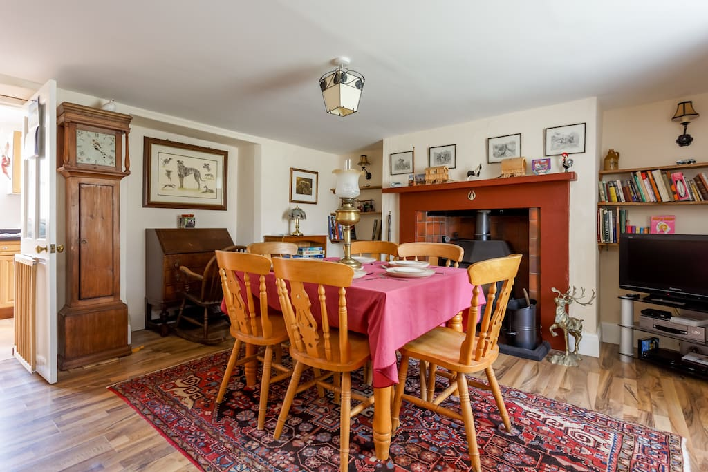 Large dining room with working log burner.