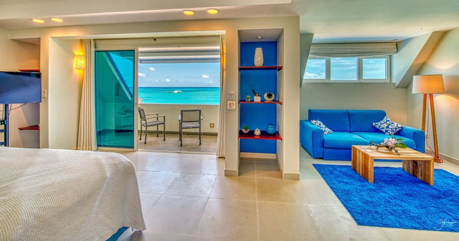 Master bathroom is designed in white and blue, upgraded with decorative plants