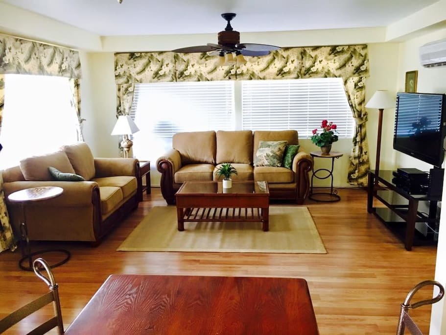Large Living Area with wood floors throughout