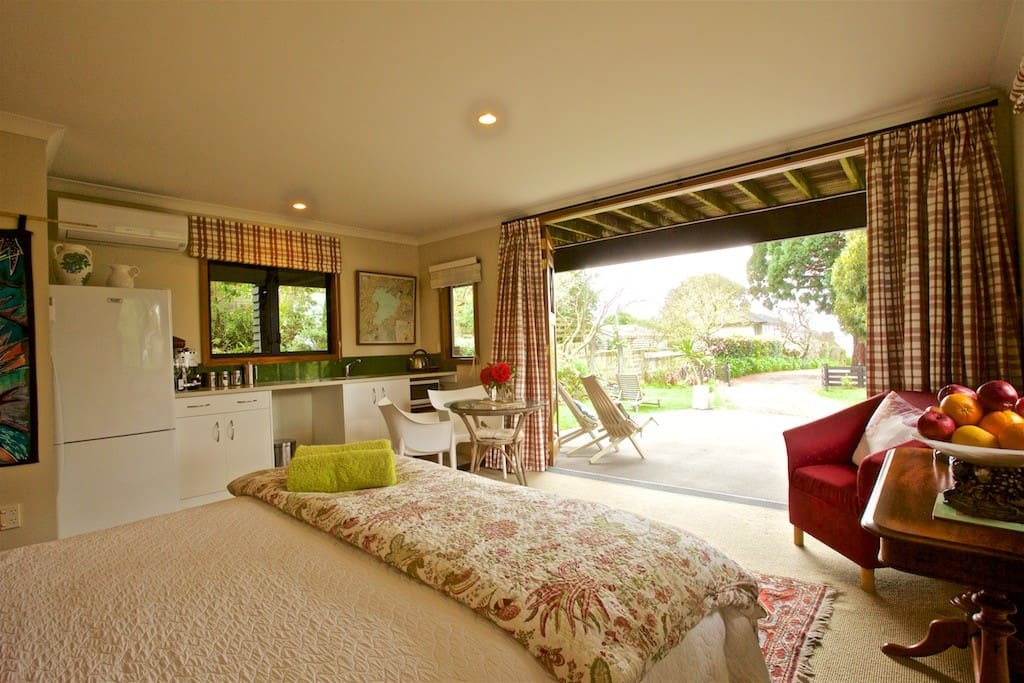 This is the main guest room which is light, bright with well appointed fixtures and fittings plus inviting furnishings.