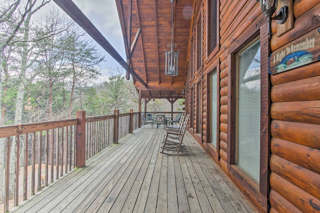 Relax on the wraparound deck with a private hot tub and mountain views.