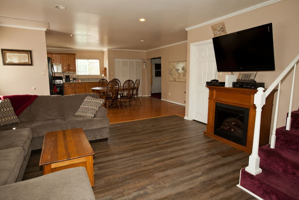 Open floor plan with living room, dining room, kitchen and laundry room.