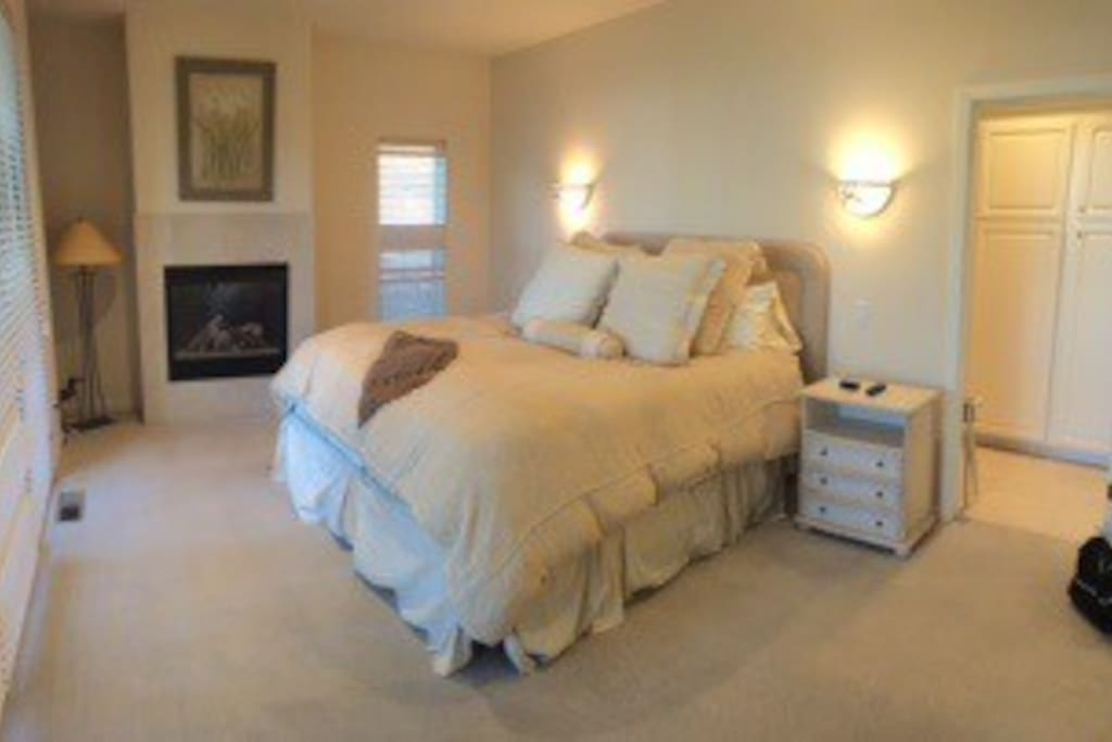 Master bedroom, with fireplace and own bathroom! Super comfy King bed.