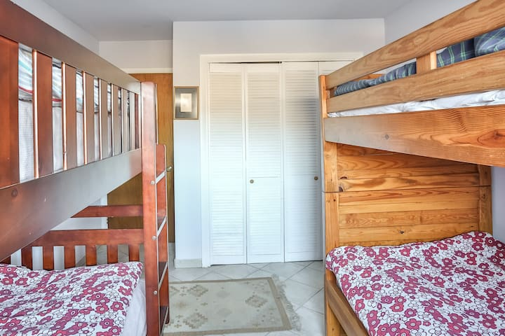 Second level bedroom with four bunk beds.